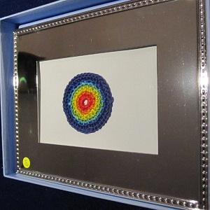 Mandala in silver frame (2)